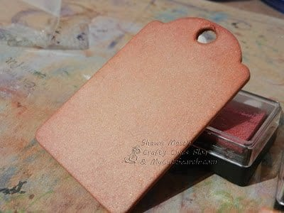 chipboard tag covered with ink